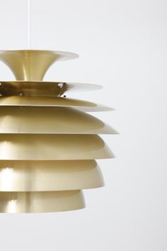 Pair of pendant lamps in brass. Made by Dema in Denmark.