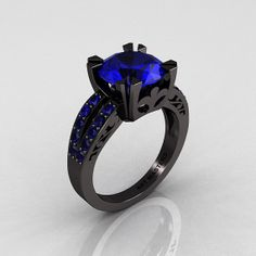 badass...Modern Vintage 14K Black Gold 3.0 Carat Blue Sapphire Solitaire Ring! Wow. This ring is gorgeous!