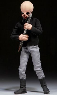 Figrin D`An Cantina Band Figure from Star Wars Episode IV A New Hope. It is made by Sideshow Collectibles and is 1:6 scale (approx. 30cm / 11.8in high).  http://star-wars.minimodelfilmstuff.co.uk/starwars-collectable/star-wars-episode-iv-a-new-hope-figrin-dan-figure-sideshow-collectibles-100085  The Figrin D'an Sixth Scale Figure features:  •Articulated Prometheus 1.2 Body with over 30 point of articulation •Sculpted Bith neck and forearms •Hand painted Figrin D'an portrait •Fab...
