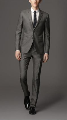 Burberry Slim Fit Wool Silk Suit, Cut from a rich blend of wool and silk, the slim fit suit features a short, closely fitted jacket and narrow tapered trousers. Sartorial pick-stitch detail, a Melton undercollar and functional button cuffs reference traditional tailoring.