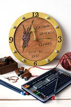 Herbarium wooden and acrylic wall clock (personalized available). Handcrafted blank clock set which will help you to collect and take home your unique botanical finds. totally irreplaceable thing for those who notice and collect tiny beauties of our wonderful planet. there is one of numerous possible decoration examples on the picture - the clock is covered with acrylic paint and wood stain and has stamped letter imprints on the surface of wooden layer. the clock set comes unpainted. the...