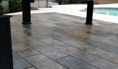 Giving your patio a high-end design at a low-cost stain will add beauty and value to your home. #ResurfacedPatio #PatioStain #ResurfacedConcrete