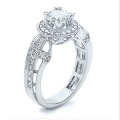 Diamond halo and cross engagement ring by Vanna K