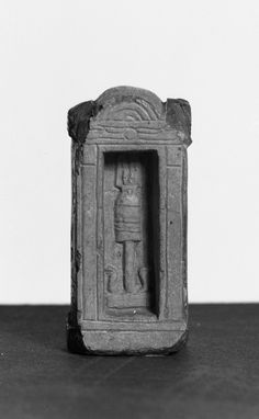 Votive Slab in the Form of a Shrine  This votive slab is shaped like a shrine. Inside the shrine in relief is a figure of Abydos representing Osiris. The piece has sunk relief on the sides and back with Isis Horus and inscriptions. The piece is broken at the top and bottom. #ArtoftheDay