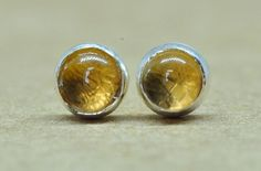 Handmade beautiful golden yellow Citrine and Silver earring studs. 3 mm Citrine gemstone, the stone of success set in sterling silver. These Citrine stud Earrings would be great for someone as bright and sunny as these gemstones. Handcrafted using tradional Silversmithing
