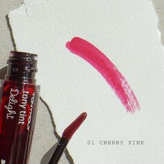 Cherry pink lip tint.