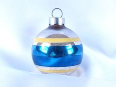 The sweet, small blue striped silver Christmas holiday ornament reminds me so much of the ornaments we had as a child.
