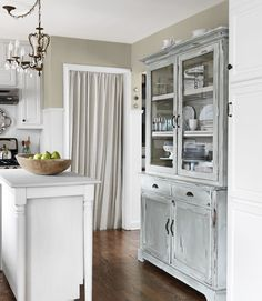 I really like the use of the cabinet, especially the distressed bluish thing going on very cool