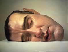 Ron Mueck, merges the surreal and hyper realism perfectly in solid form.