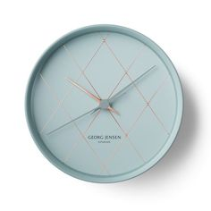 www.georgjensen.com/global/ A beautiful clock in strong Georg Jensen style. And the color scheme is so stunning.