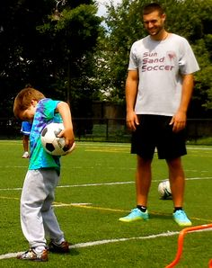 Matthew working on his ball-handling and coordination with Coach Nick