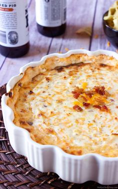This crack dip is so good it's addicting, filled with cheese, bacon bits, more cheese and sour cream.