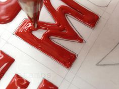 Learn how to make royal icing transfers in this tutorial by SweetAmbs.