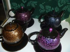 Hand painted one cup teapot, all one of a kind $35.00 includes shipping.  These are great for anyone with a desk at work because they are small enough to fit in a drawer..the tea steeps in the little pot on top while the cup under the pot is warming up too..