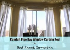 Restoration Beauty: Conduit Pipe Bay Window Curtain Rod + Bed Sheet Curtains