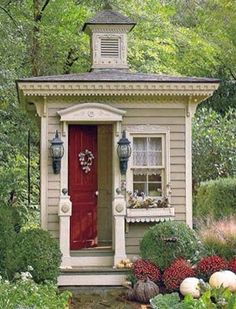 Tiny cottage house / garden shed beige and dark red