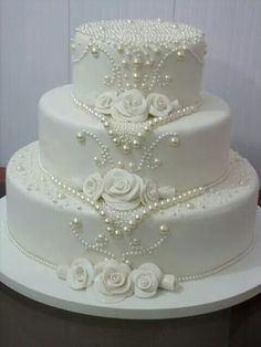 Never ever under no scenarios put your wedding cake near the dance floor because the boogie bopper might trigger a lotta heartache. A steady table is a should for the cutting of the cake. White Wedding Cakes, Elegant Wedding Cakes, Elegant Cakes, Beautiful Wedding Cakes, Gorgeous Cakes, Wedding Cake Designs, White Weddings, Bling Wedding Cakes, Wedding Cake Pearls