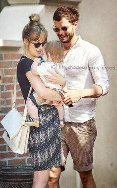 Christian Grey and Ana Steele with Teddy. 50 Shades Trilogy, Fifty Shades Series, Jamie Dornan, 50 Shades Freed, Fifty Shades Darker, Cristian Grey, Ana Steele, Shades Of Grey Movie, Mr Grey