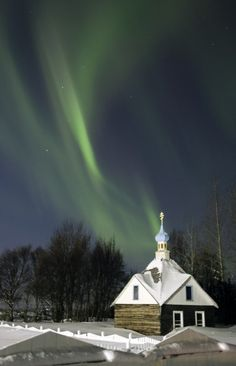 The northern lights or aurora borealis fill the western sky Friday, March 9, 2012, above the Russian Orthodox Saint Nicholas Memorial Chapel in Kenai, Alaska. The display of lights came in the aftermath of a solar storm that struck Earth on Thursday