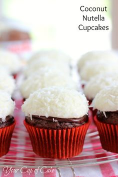 Coconut Nutella Cupcakes {from Your Cup of Cake} had these at a bake sale and they were awesome! Super moist and delicious