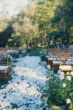 Let your wedding ceremony double as a secret garden with an aisle of white rose petals.