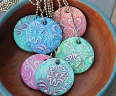 Damask Polymer Clay Pendants! Use texture plates, or rubber stamps (embossing folders?), bake and paint. These would be very cool cut into Cairn terrier shapes for a rescue fundraiser.