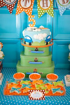 """I like the way the cake is on a themed pedestal. Gray asked for a """"tall cake."""" This may be a less expensive option than a 3 tiered cake."""