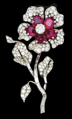 Beautiful floral brooch set with diamonds and rubies.