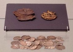 Pouch of leather with gold print and silver coins. C. 1010 AD.