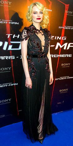 EMMA STONE   -- Gucci gown with bronze crystal embroidery, Christian Louboutin pumps and deep crimson lips.