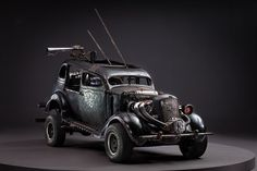 """Mad Max: Fury Road Vehicles Are Not Exactly """"Shiny And Chrome"""" No vehicle that hopes to reach the Green Place all shiny and chrome comes to the end of the wasteland without some serious scars to show for the journ. Mad Max Fury Road, Monster Car, Death Race, Unique Cars, Dieselpunk, Custom Cars, Diorama, Badass, Cool Photos"""