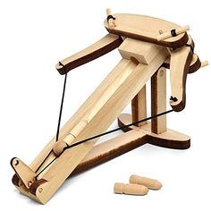 $15.60 Mini Ballista: The ultimate office warfare kit It is laser cut from select hardwood for easy assembly and reliable performance. This tabletop kit has been designed for simple assembly.  Designed with interlocking parts, a simple, reliable trigger, high strength cordage and lightweight projectiles this ballista is incredibly durable. Three easy-to-follow rules for public demonstration are provided to ensure everyones safety.