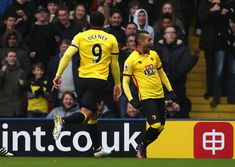 Roberto Pereyra of Watford (R) celebrates scoring his sides second goal during the Premier League match between Watford and Leicester City at Vicarage Road on November 19, 2016 in Watford, England.