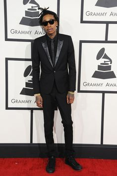 Wiz Khalifa arrives at the 56th Annual GRAMMY Awards on Jan. 26 in Los Angeles