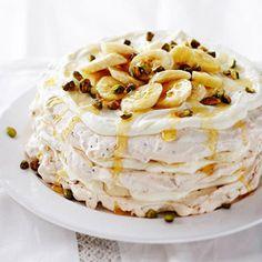 Layers of meringue, bananas, pistachio nuts, and a whipped cream mixture create this elegant dessert recipe.