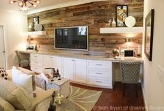 Reclaimed wood wall in Birmingham Parade of Homes Decor Ideas. Nice to camouflage the tv a bit #woodwall #reclaimedwood #familyroom