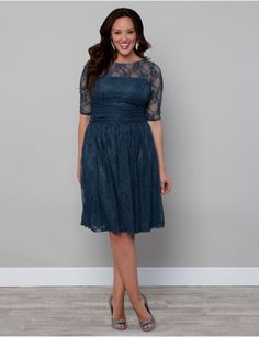 Luna Lace Dress | Lane Bryant.  Comes in black or navy blue... LOVE LOVE LOVE the navy blue!  It'd look killer with my pale skin and red hair :)
