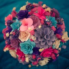 This paper bouquet is just a taste of the handmade details you'll see in this pastel-pretty wedding. It's got TONS of DIY inspiration! #weddinggawker. Photography via http://www.facebook.com/clickclickbang