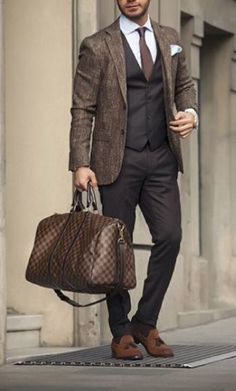 Opt for a brown wool coat and black suit pants for a sharp, fashionable look. For footwear go down the casual route with brown suede tassel loafers.