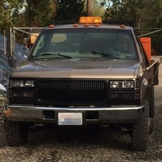 Kasey's 1997 GMC Sierra with Black Front Grill and Headlights Set