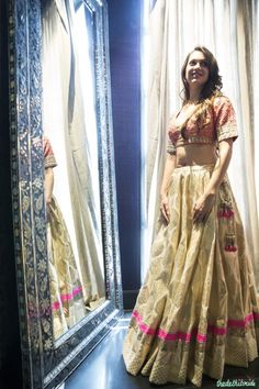 Pastel pink blouse with white chanderi lehenga by Anita Dongre