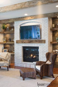 In this great room, undermount lighting accentuates floating shelving made from oak barn siding. like the side walls for lacy's family room Fireplace Shelves, Fireplace Built Ins, Home Fireplace, Fireplace Remodel, Living Room With Fireplace, Fireplace Design, Mantel Shelf, Fireplaces, Living Room Remodel