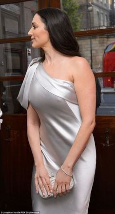 Shapely: Lauren's outfit choice made the most of her curves in the metallic gown, which sh...