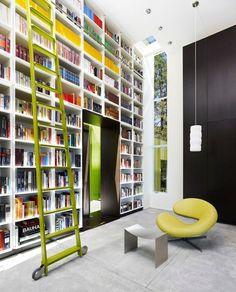 Modern Bookshelves Design Green House Love the chair and green ladder. Library Bookshelves, Library Ladder, Modern Bookshelf, Bookshelf Design, Bookshelf Ladder, Bookcases, Library Wall, Book Shelves, Green Shelves