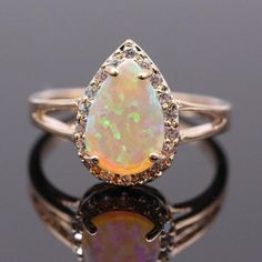 As a gift to that special someone or as a treat for yourself, this gorgeous Fire Opal Teardrop Gold Ring is sure to get attention.The timeless design features a