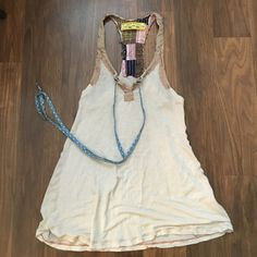 SALE!!! Free People tank Worn a couple of times. Free People tank top SALE PRICE IS FINAL. NO TRADES. NO OFFERS. Free People Tops Tank Tops