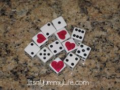 Valentine Bunco Dice....I covered the 1′s with heart stickers.  This makes them wild!!