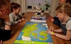 "The ""Refugee Game"" challenges the players to block migrants as they attempt to enter ""happy little Denmark."""