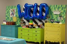 "Wild party ideas! Here's a fun, super bright and bold take on ""Where the Wild Things Are"". Love the oversized WILD balloons."