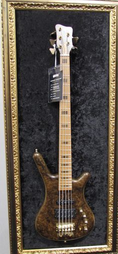 """Warwick five string bass Framed with old-school gold wood frame with crushed black velvet """"canvas"""""""